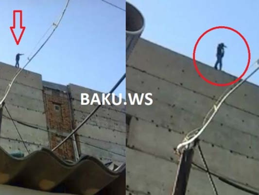 Прохожий грозящемуся совершить самоубийство мужчине в Баку: «Бросайся…» – ВИДЕО